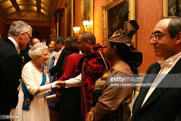Queen Elizabeth II meets the Ambassador for Lesotho as she hosts a reception at Buckingham Palace for members of the diplomatic corps on November 21...
