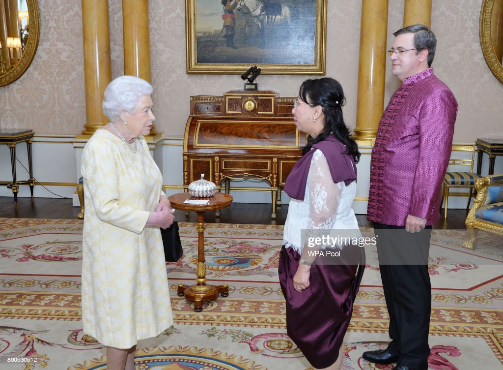 Queen Elizabeth II meets the Ambassador of Cambodia Dr Soeung Rathchavy accompanied by Mr Vladimir Maximov, during a private audience at Buckingham Palace on October 12, 2017 in London, United Kingdom.