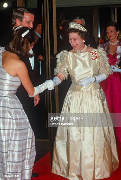 Queen Elizabeth II meets the Canadian Prime Minister Brian Mulroney on arrival at the Winnipeg Convention Centre in Winnipeg Canada on October 6 1984...