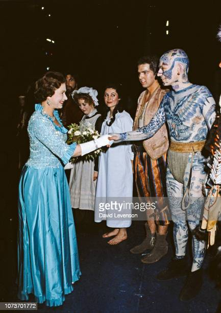 Queen Elizabeth II meets the cast of the Royal Shakespeare Company's 'Peter Pan' backstage after the performance at the Barbican Theatre in London on...