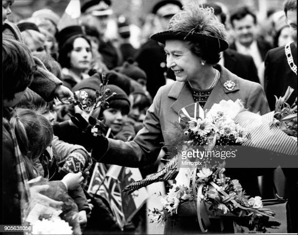 Queen Elizabeth II meets the happy crowd on her walkabout after opening the Delyn Borough Council Offices in Flint North Wales The Queen is on her...