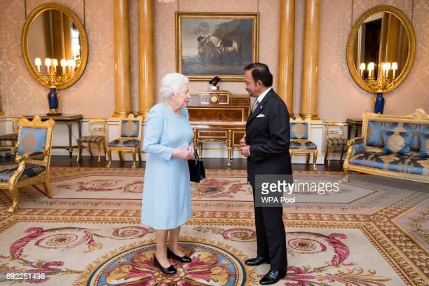 Queen Elizabeth II meets the Sultan of Brunei during a private audience at Buckingham Palace on December 14 2017 in London England