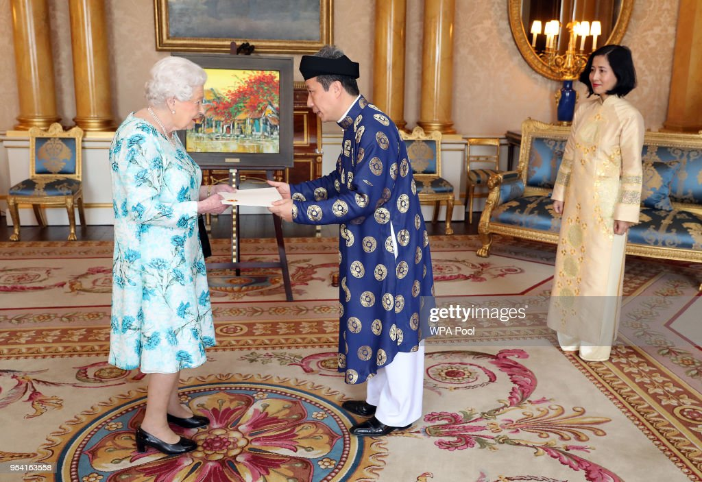 Queen Elizabeth II meets Tran Ngoc An, the Ambassador from the Socialist Republic of Vietnam, as he presents his Letters of Credence with his wife, Doan Thi Phuong Dung (right), during a private audience at Buckingham Palace on May 3, 2018 In London, England.