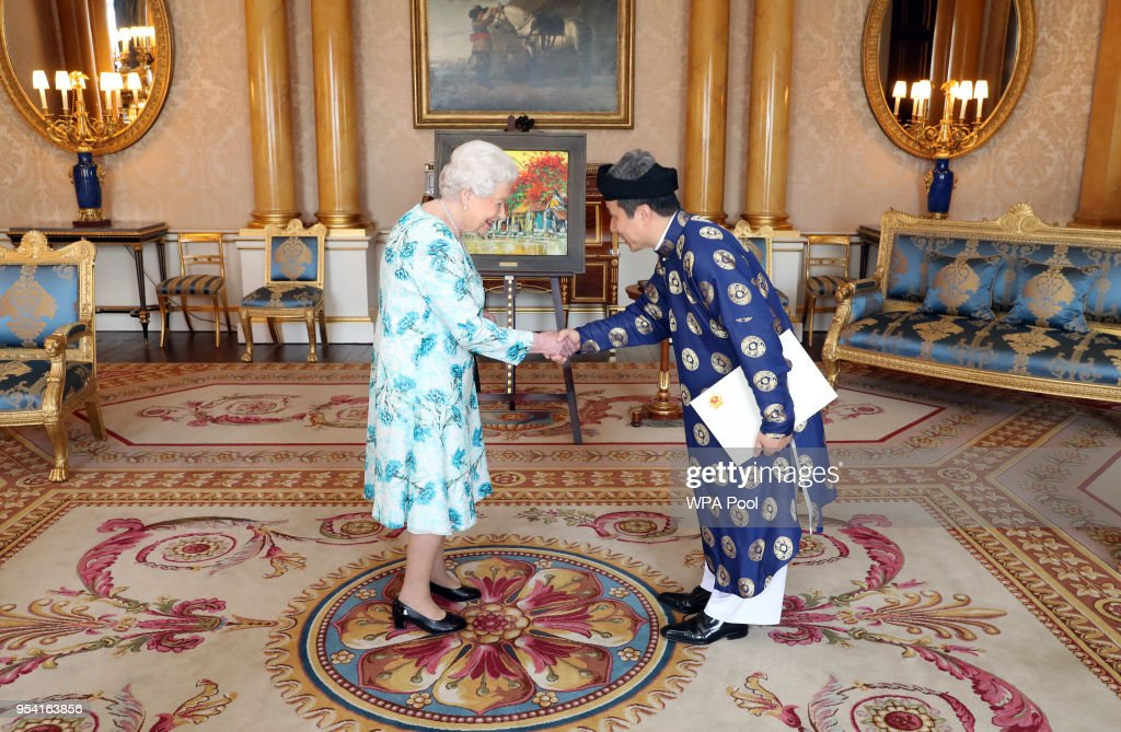 Queen Elizabeth II meets Tran Ngoc An, the Ambassador from the Socialist Republic of Vietnam, as he presents his Letters of Credence during a private audience at Buckingham Palace on May 3, 2018 In London, England.