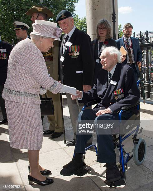 Queen Elizabeth II meets Veteran John Dean during the 70th Anniversary commemorations of VJ Day at St MartinintheFields Church on August 15 2015 in...