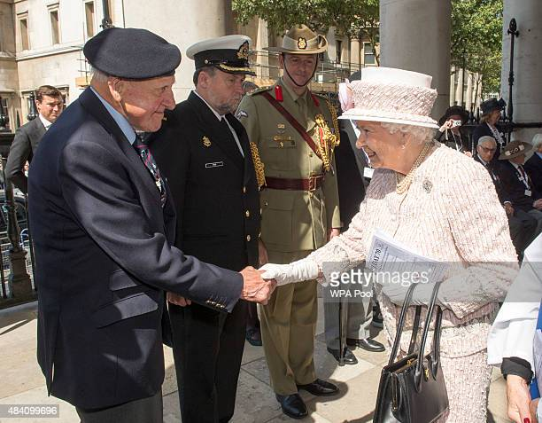 Queen Elizabeth II meets Veteran Robert Hucklesbury during the 70th Anniversary commemorations of VJ Day at St MartinintheFields Church on August 15...