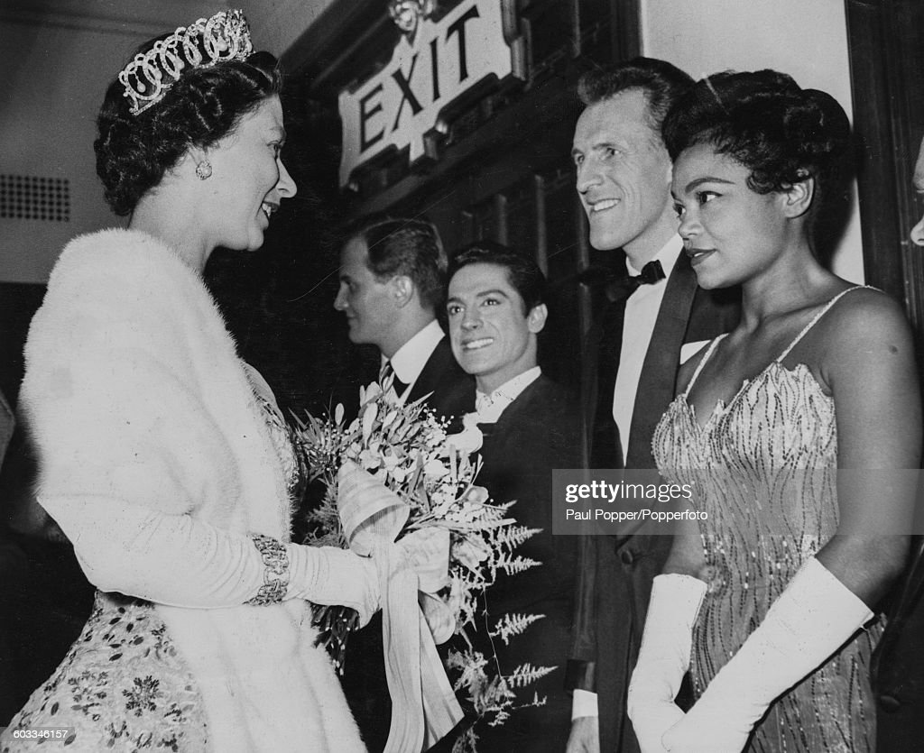Queen Elizabeth II meets with American singer Eartha Kitt along with a line-up of stars including (L-R) American singer Pat Boone, Spanish dancer Antonio and English entertainer and comedian Bruce Forsyth, following the Royal Variety Performance at the London Coliseum on November 3rd 1958.