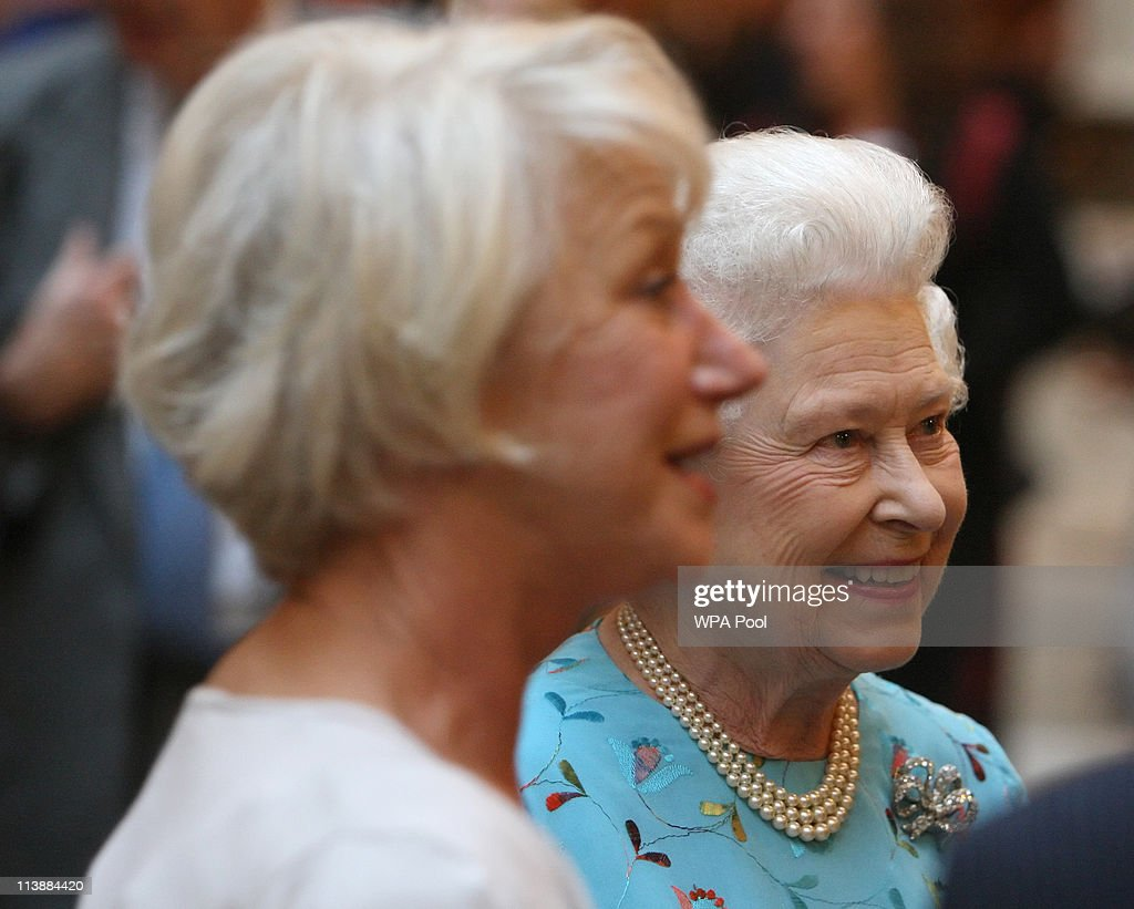 Queen Elizabeth II meets with Dame Helen Mirren (L) at a performing Arts reception at Buckingham Palace on May 9, 2011 in London, England.