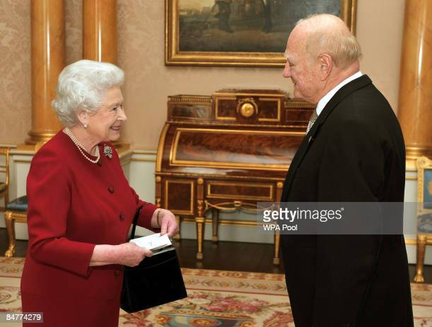 Queen Elizabeth II meets with El Salvador's ambassador to London Dr Roberto AvilaAvilez at Buckingham Palace on February 13 2009 in London England