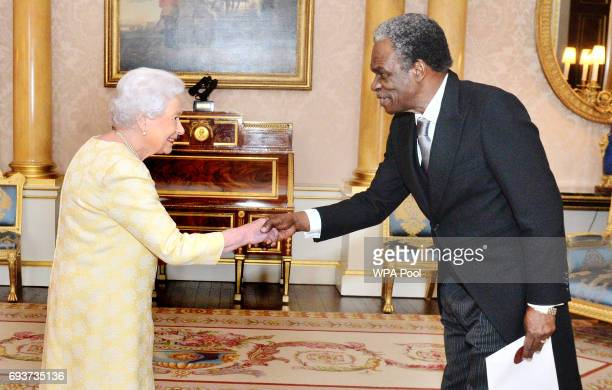 Queen Elizabeth II meets with His Excellency Orville London the High Commissioner of the Republic of Trinidad and Tobago during a private audience in...