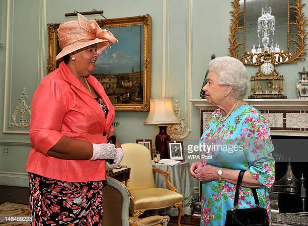 Queen Elizabeth II meets with Mrs Aloun NdombetAssamba the High Commissioner for Jamaica during a private audience at Buckingham Palace on July 17...