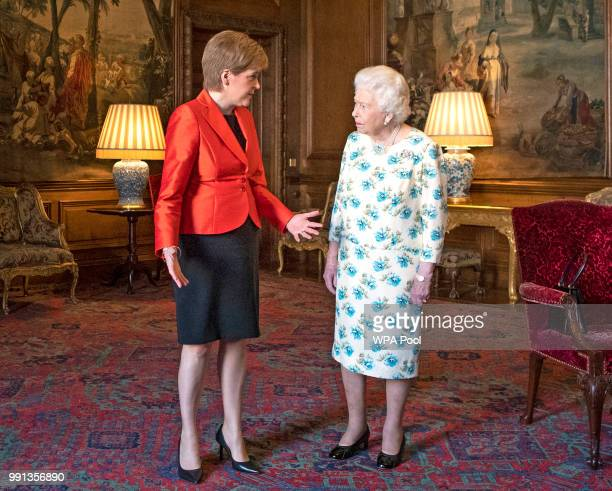 Queen Elizabeth II meets with Scotland's First Minister Nicola Sturgeon during a private audience at the Palace of Holyrood House on July 4 2018 in...