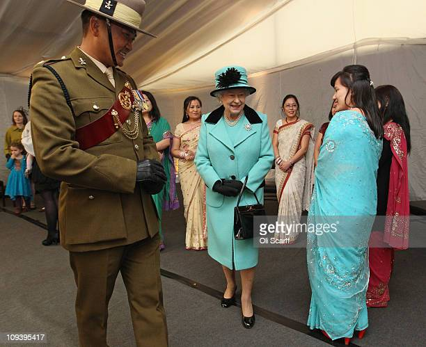 Queen Elizabeth II meets wives of serving Gurkha servicemen on her visit to Invicta Park Barracks on February 24 2011 in Maidstone England During her...