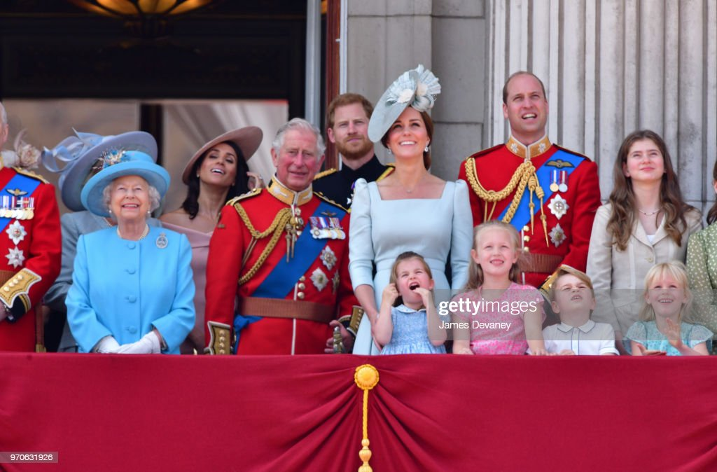 Queen Elizabeth II, Meghan, Duchess of Sussex, Prince Charles, Prince of Wales, Prince Harry, Duke of Sussex, Catherine, Duchess of Cambridge, Prince William, Duke of Cambridge, Princess Charlotte of Cambridge, Savannah Phillips, Prince George of Cambridge and Isla Phillips stand on the balcony of Buckingham Palace during the Trooping the Colour parade on June 9, 2018 in London, England.