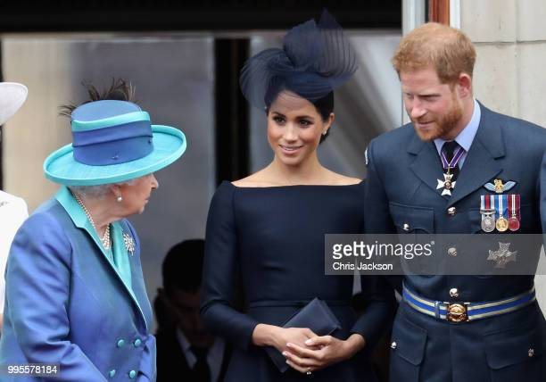 Queen Elizabeth II, Meghan, Duchess of Sussex, Prince Harry, Duke of Sussex watch the RAF flypast on the balcony of Buckingham Palace, as members of...