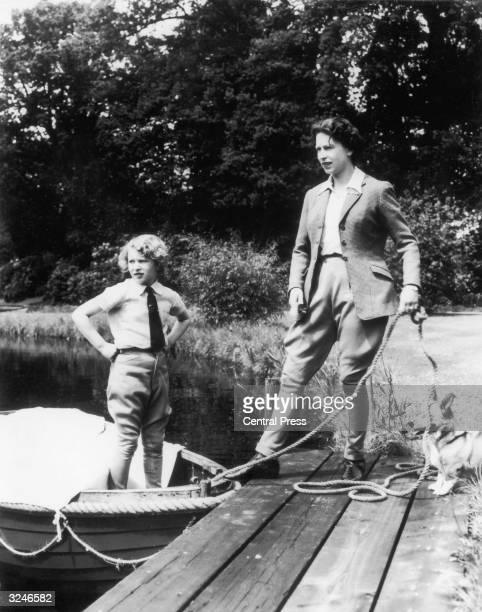 Queen Elizabeth II messing about in boats at Frogmore Windsor with her daughter Princess Anne