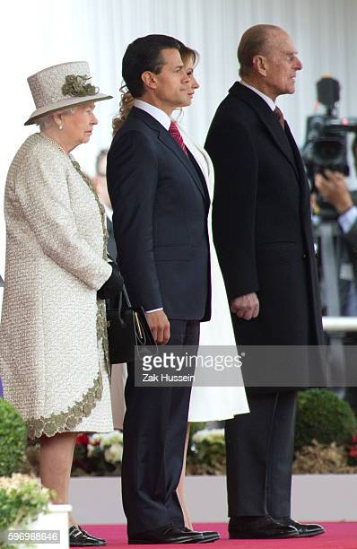 Queen Elizabeth II Mexican President Enrique Pena Nieto and Prince Philip Duke of Edinburgh during a ceremonial welcome for The President Of United...