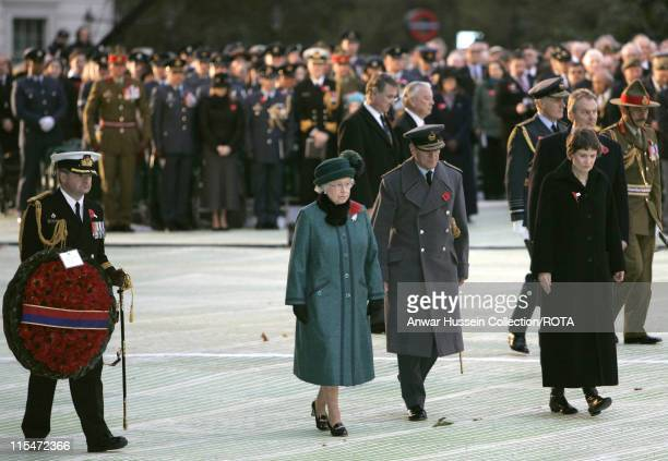 Queen Elizabeth II, New Zealand Prime Minister Rt. Hon Helen Clark and Warrant Officer Wal Wallace attend the official dedication of the New Zealand...
