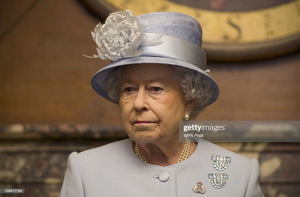 Queen Elizabeth II observes a ceremony during a visit to the Admiralty Board and Admiralty House on 23 November, 2011 in London, England. The Duke of Edinburgh was inaugurated as Lord High Admiral as well as formally receiving the Letters Patent, followed by a lunch given by the First Sea Lord at Admiralty House.