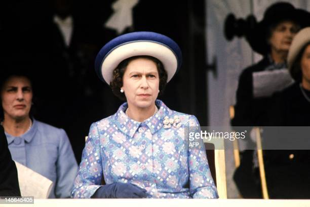 Queen Elizabeth II of England attends a horse race at Longchamp racecourse, outside Paris in May 1972 during her five-day official visit in France.