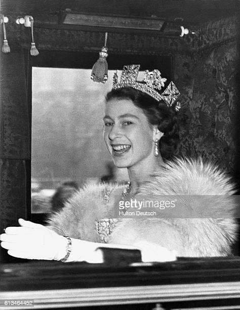 Queen Elizabeth II of England drives to Westminster to open Parliament in State in the first year of her reign
