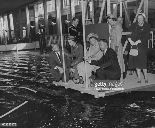 Queen Elizabeth II of Great Britain and Queen Juliana of the Netherlands being shown hydraulic experiments for a planned new harbour entrance for the...