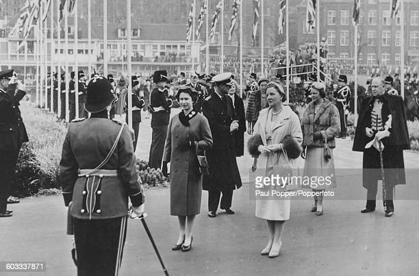 Queen Elizabeth II of Great Britain stands with Queen Juliana of the Netherlands with Prince Philip and Princess Irene in the background as they...