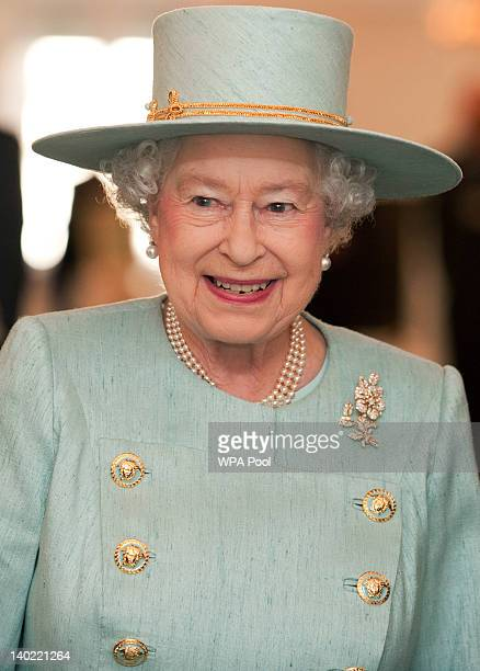 Queen Elizabeth II officially opens the Fortnum Mason Diamond Jubilee Tea Salon while visiting Fortnum Mason store on March 1 2012 in London England...