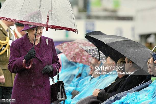 Queen Elizabeth II on a trip to Northern Ireland chats with disabled soldiers of the Royal Irish Regiment and members of their family on October 6,...