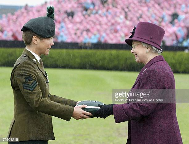 Queen Elizabeth II on a trip to Northern Ireland presents Corporal Claire Withers with the Conspicuous Gallantry Cross which was received on behalf...