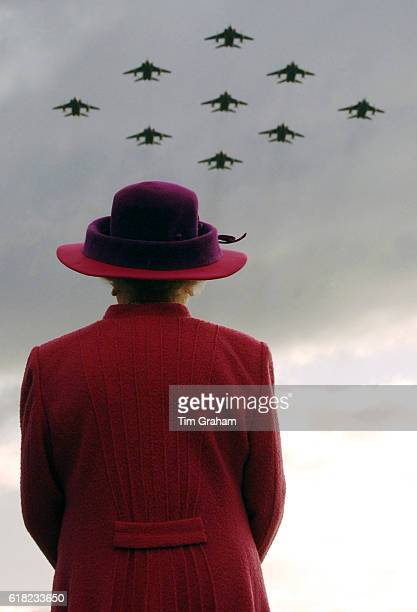 Queen Elizabeth II on a visit to RAF Coltishall watches RAF Jaguar planes in a diamond 9 formation.