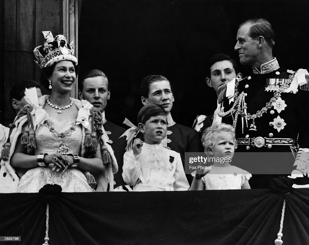 Queen Elizabeth II on the balcony of Buckingham Palace after her Coronation ceremony with (left to right); Prince Charles, Princess Anne and The Prince Philip, Duke of Edinburgh.