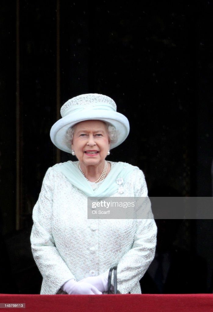 Queen Elizabeth II on the balcony of Buckingham Palace after the service of thanksgiving at St.Paul's Cathedral on June 5, 2012 in London, England. For only the second time in its history the UK celebrates the Diamond Jubilee of a monarch. Her Majesty Queen Elizabeth II celebrates the 60th anniversary of her ascension to the throne. Thousands of wellwishers from around the world have flocked to London to witness the spectacle of the weekend's celebrations.
