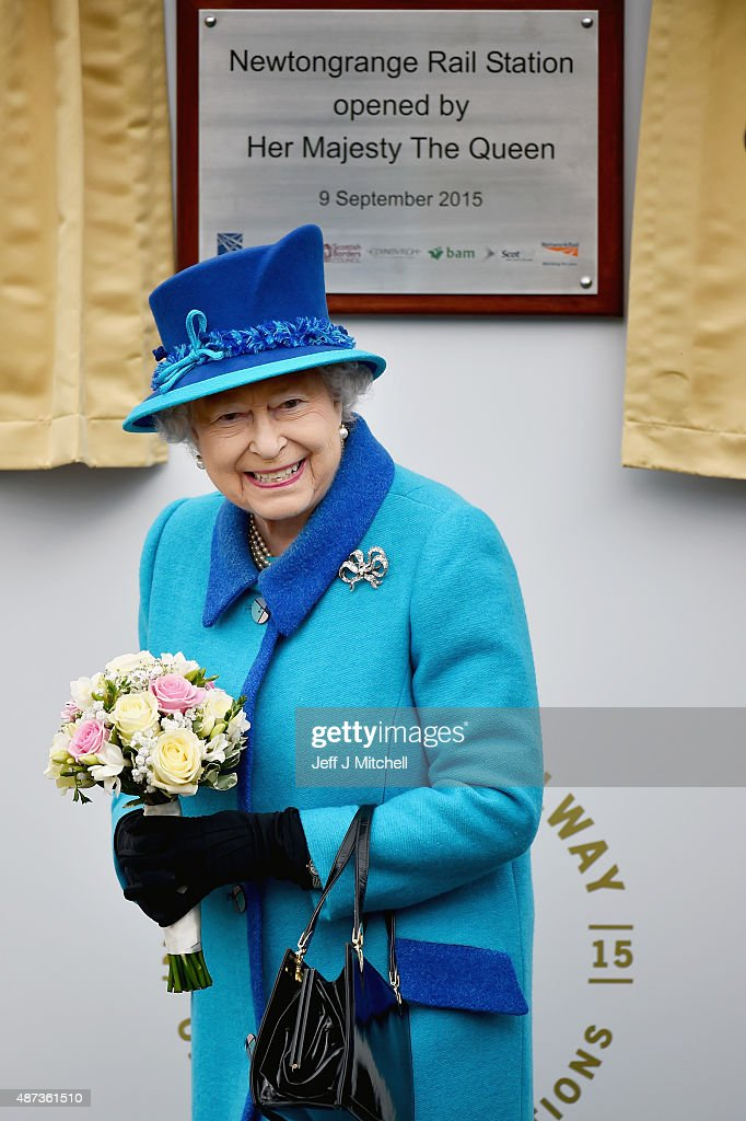 Queen Elizabeth II opens Newtongrange Station after arriving on the steam locomotive the 'Union of South Africa' on September 9, 2015 in Newtongrange , Scotland.Today, Her Majesty Queen Elizabeth II becomes the longest reigning monarch in British history overtaking her great-great grandmother Queen Victorias record by one day. The Queen has reigned for a total of 63 years and 217 days. Accompanied by her husband The Duke of Edinburgh, she has today opened the new Scottish Borders Railway.