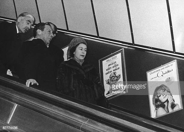 Queen Elizabeth II opens the new Victoria Line on the London Underground 7th March 1969 Here she travels down the escalator at Green Park Station...
