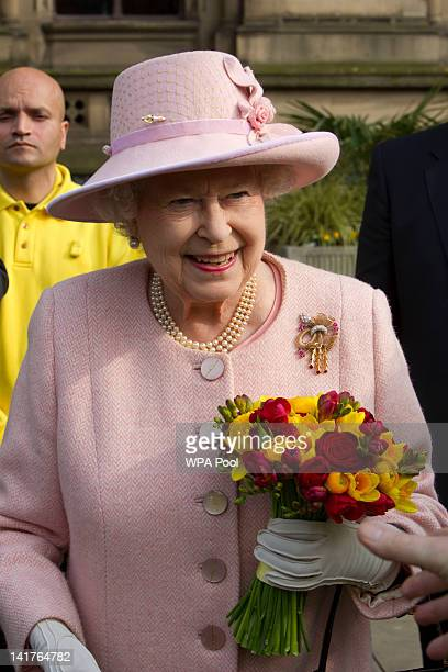 Queen Elizabeth II outside Manchester Town Hall on March 23 2012 in Greater Manchester northwest England The Queen and her husband Prince Philip the...