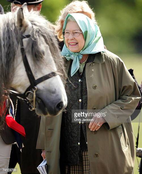 Queen Elizabeth II pats her horse Balmoral Melody as she attends the Royal windsor Horseshow on May 11 2007 in Windsor England This is the second day...