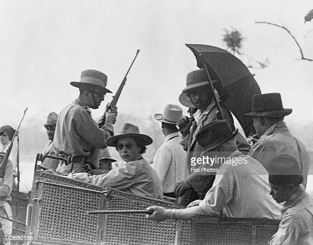 Queen Elizabeth II perched on an elephant howdah during a tiger hunt in Meghauli Nepal 27th February 1961 To her left is King Mahendra of Nepal...