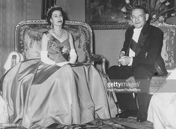 Queen Elizabeth II pictured at a meeting with President Rene Coty of France before a State banquet at the Louvre in Paris, April 11th 1957.