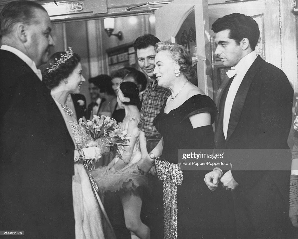 Queen Elizabeth II pictured being introduced to singer and actress Gracie Fields, with comedian Max Bygraves (left) and singer Frankie Vaughan (right) looking on, at the Royal Variety Performance at the London Palladium, November 18th 1957.