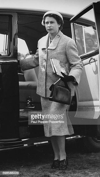 Queen Elizabeth II pictured getting out of her car as she arrives at Windsor Horse Show England May 25th 1955
