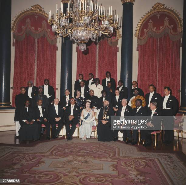 Queen Elizabeth II pictured in centre front row with Commonwealth Prime Ministers as they attend a dinner at Buckingham Palace in London on 7th...
