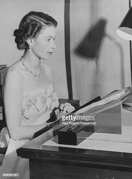 Queen Elizabeth II pictured in front of a script as she makes her Christmas Day broadcast from Government House in Auckland New Zealand on 25th...