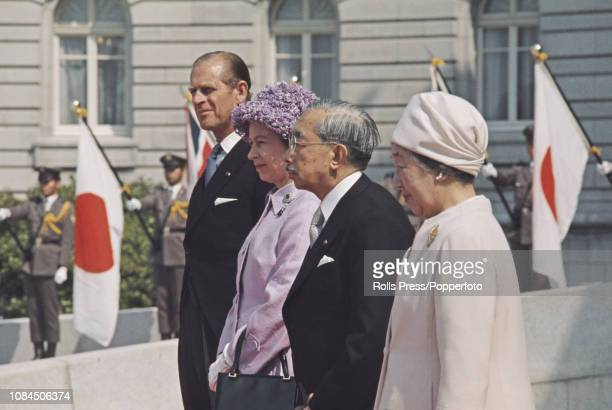 Queen Elizabeth II pictured standing together with, from left, Price Philip Duke of Edinburgh, Emperor Hirohito of Japan and Empress Nagako outside...