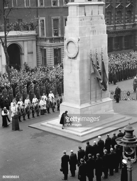Queen Elizabeth II places her wreath of red poppies on to the Cenotaph in Whitehall London when she led the nation's homage to the dead of two world...