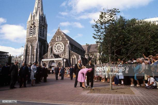 Queen Elizabeth II plants a commemorative tree in Cathedral Square, Christchurch, during her Silver Jubilee tour of New Zealand. On the left is the...