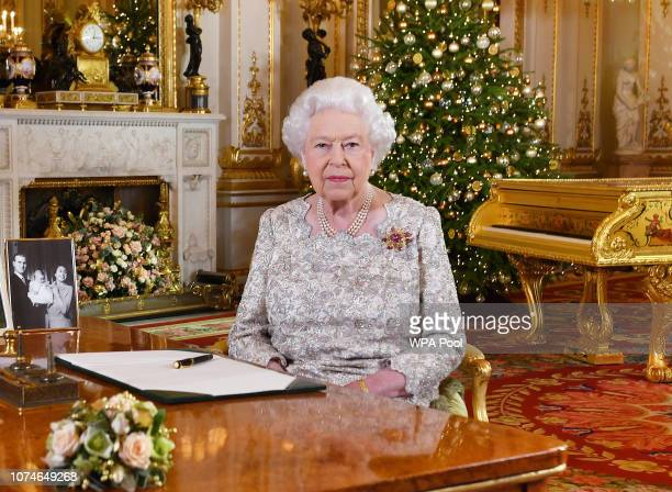 Queen Elizabeth II poses for a photo after she recorded her annual Christmas Day message in the White Drawing Room at Buckingham Palace in a picture...