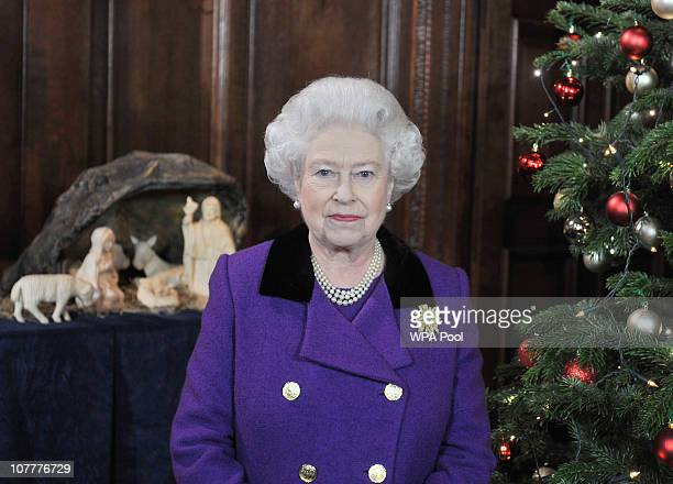 Queen Elizabeth II poses for a photo during the recording of her Christmas Day Speech to the Commonwealth in the Chapel Royal at Hampton Court Palace...