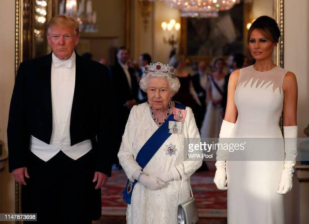 Queen Elizabeth II , poses for a photo with U.S. President Donald Trump and First Lady Melania Trump ahead of a State Banquet at Buckingham Palace on...