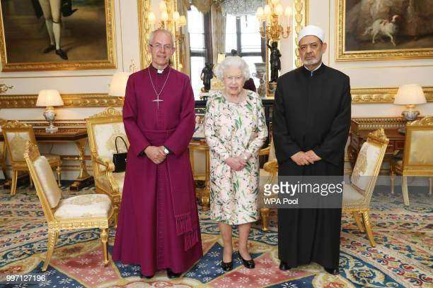 Queen Elizabeth II poses for a photograph with Justin Welby the Archbishop of Canterbury and Sheikh Ahmad AlTayeb Grand Imam of Al Azhar during an...